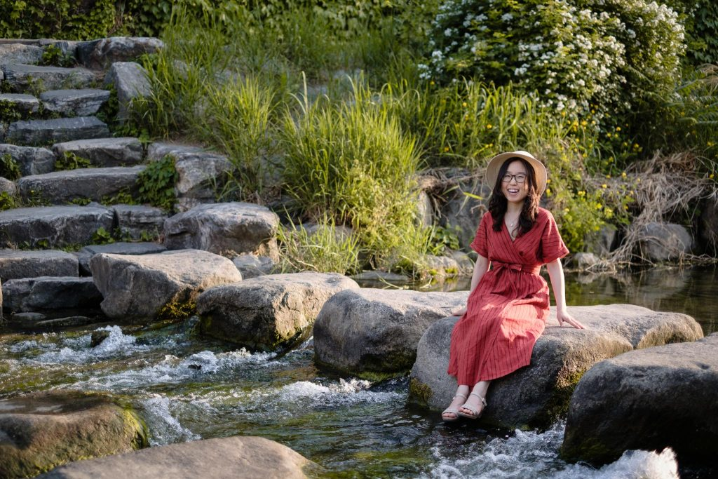 Mina Oh seated beside Cheongye Stream - with a happy smile on her face.