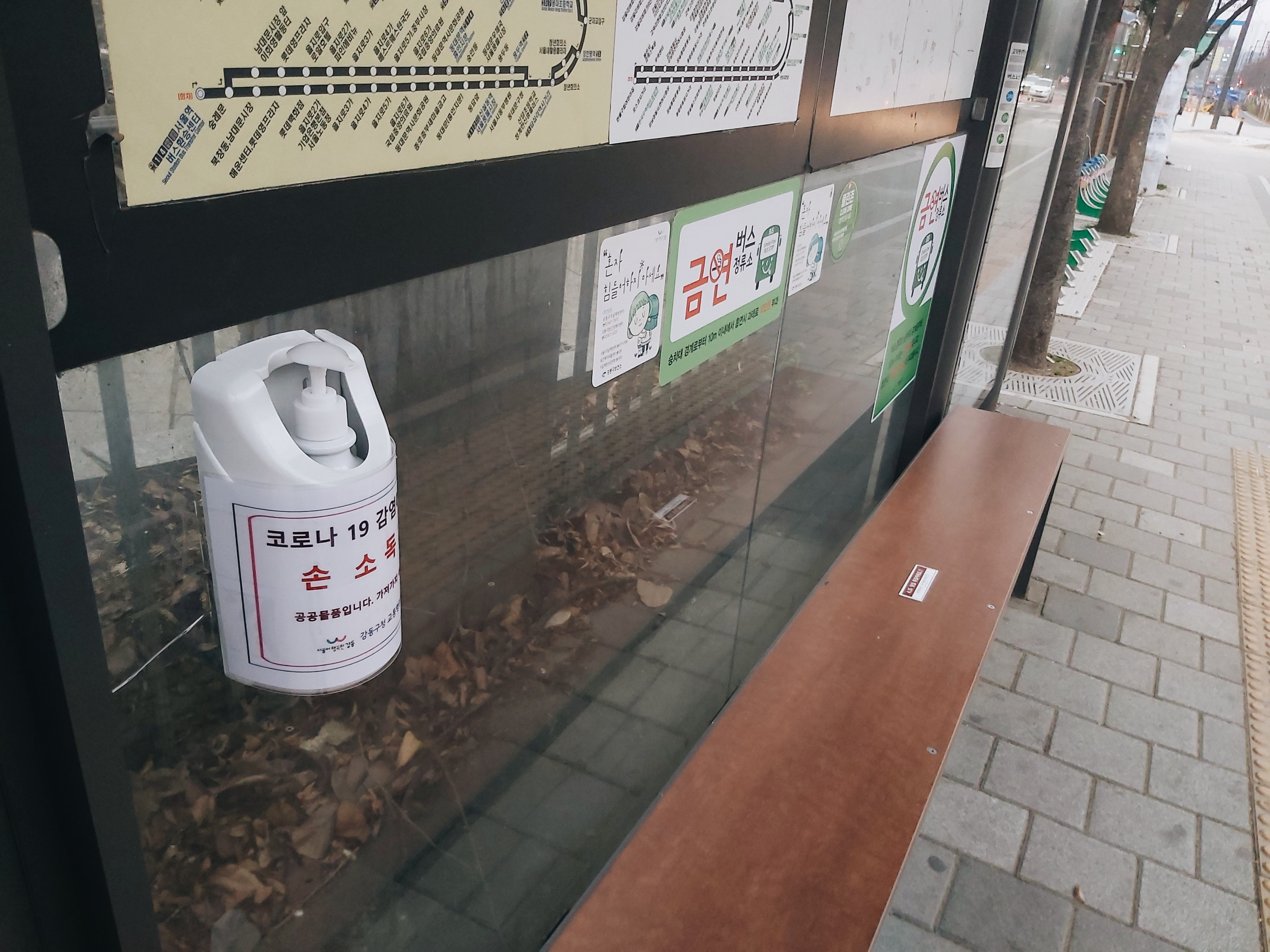 Hand sanitizer dispensers are found at practically every bus stop for the public to use.