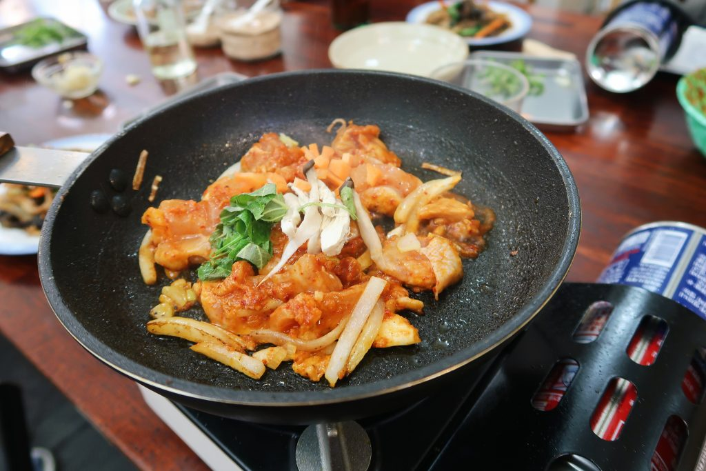 Preparing Dakgalbi in a frying pan (Korean cuisine).
