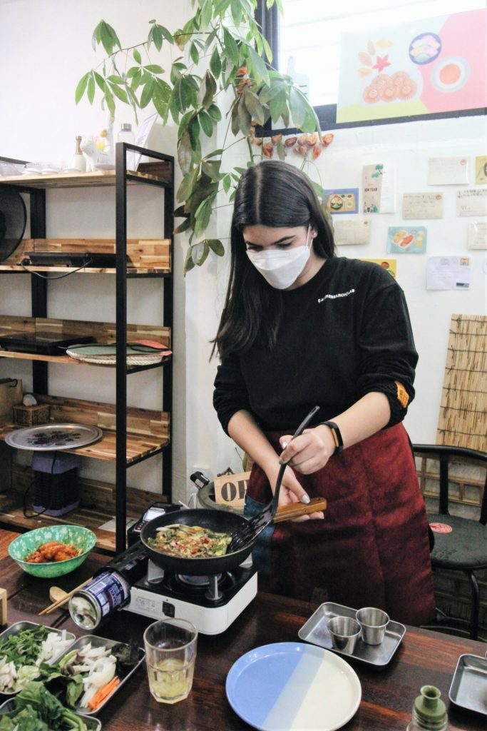 A photo of me making 해물파전 (Haemul Pajeon/Seafood pancake)