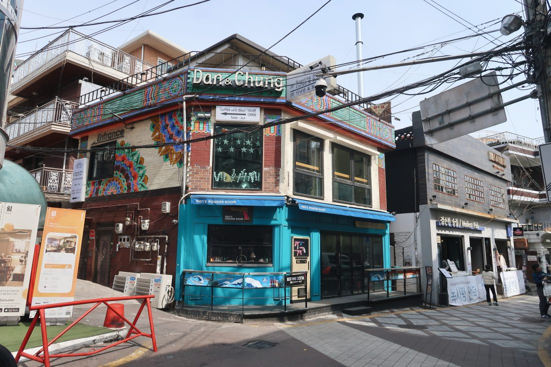 A colourful blue building and one with mandala designs.