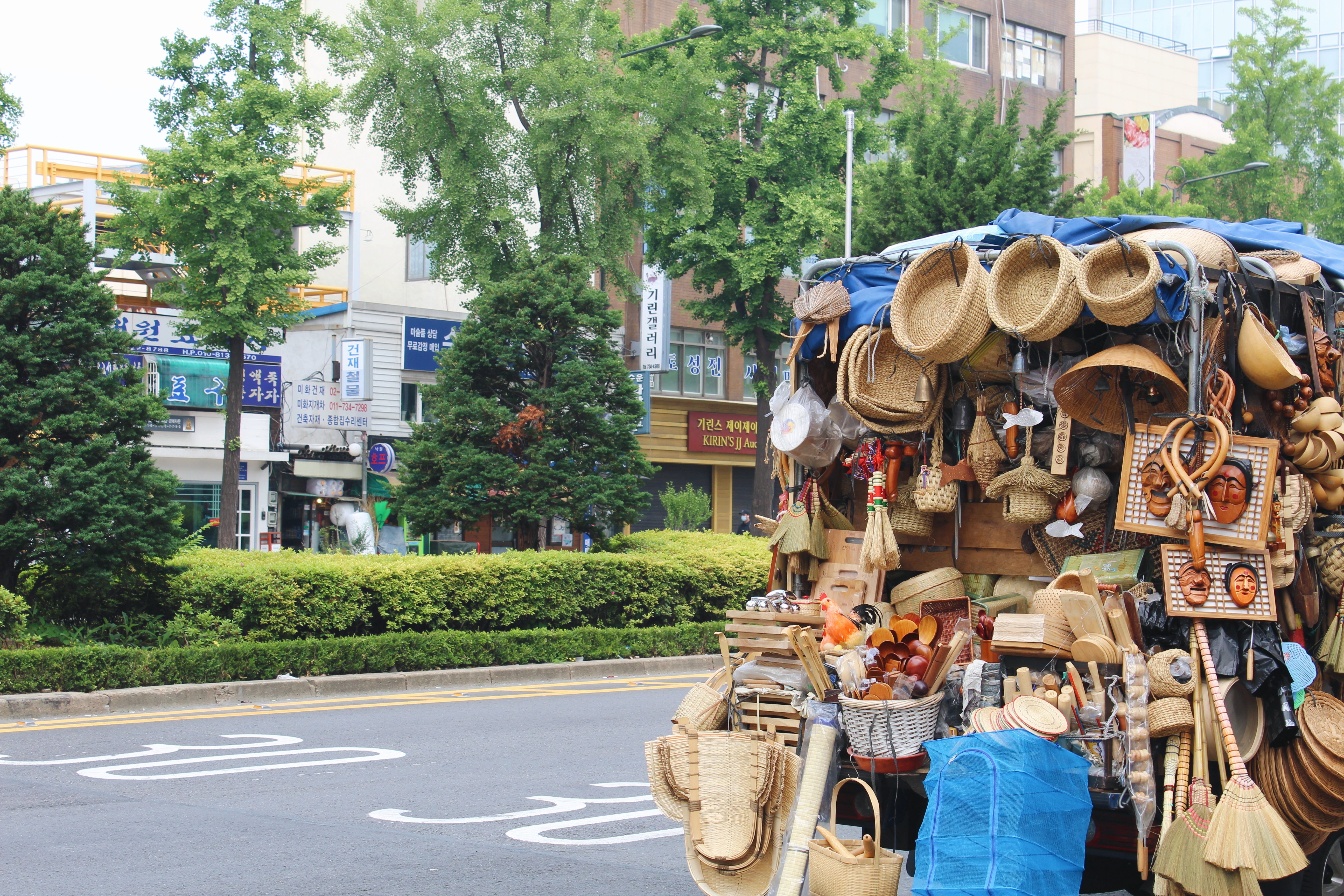 A cart filled with (what I assume to be) handmade wooden and woven objects.