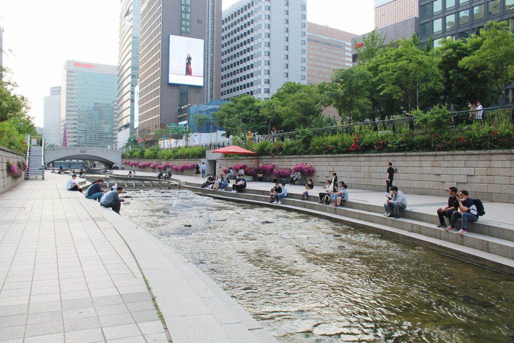 People sitting by the Cheonggyecheong