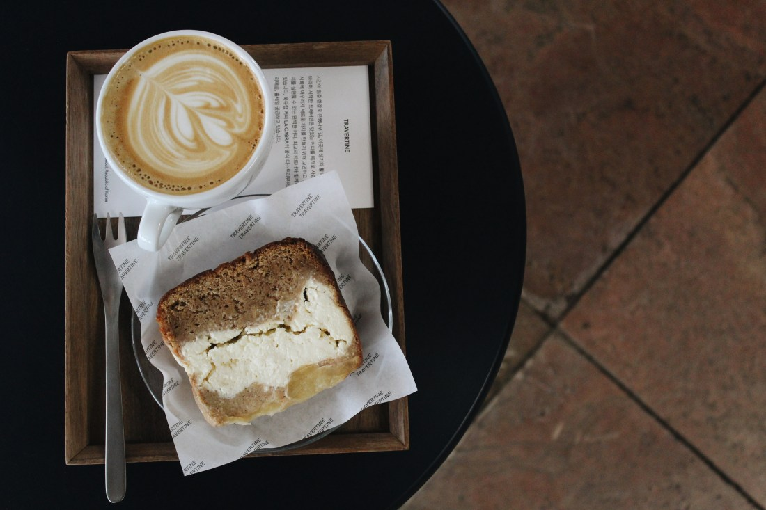 A latte paired with an apple cinnamon pound cake at Travertine